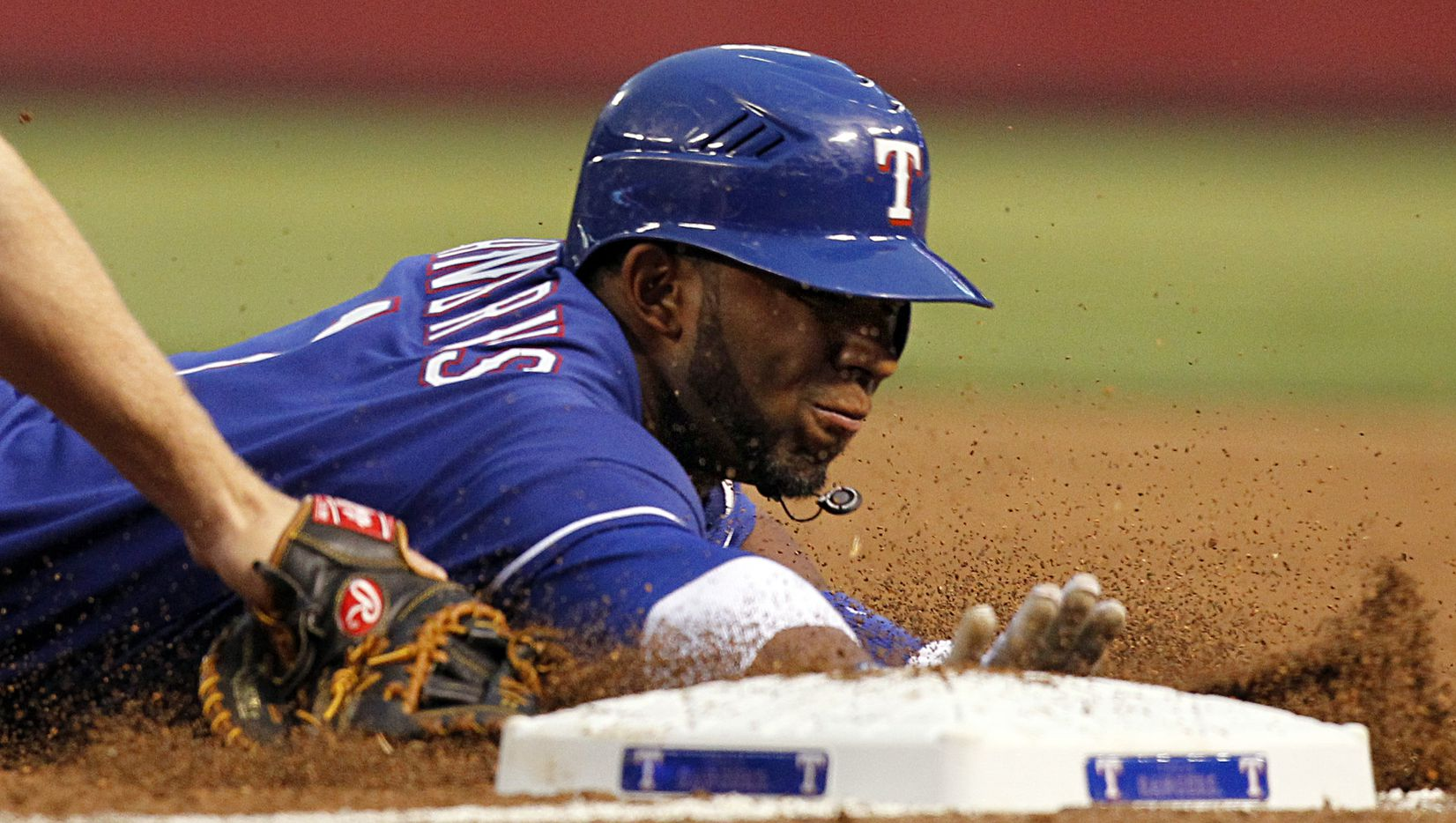 Texas Rangers Elvis Andrus dives back to first just under the tag by Los Angeles Angels first baseman Mark Trumbo in the first inning at the Rangers Ballpark in Arlington, Wednesday, April 20, 2011. Andrus was picked off shortly thereafter. (Tom Fox/The Dallas Morning News)