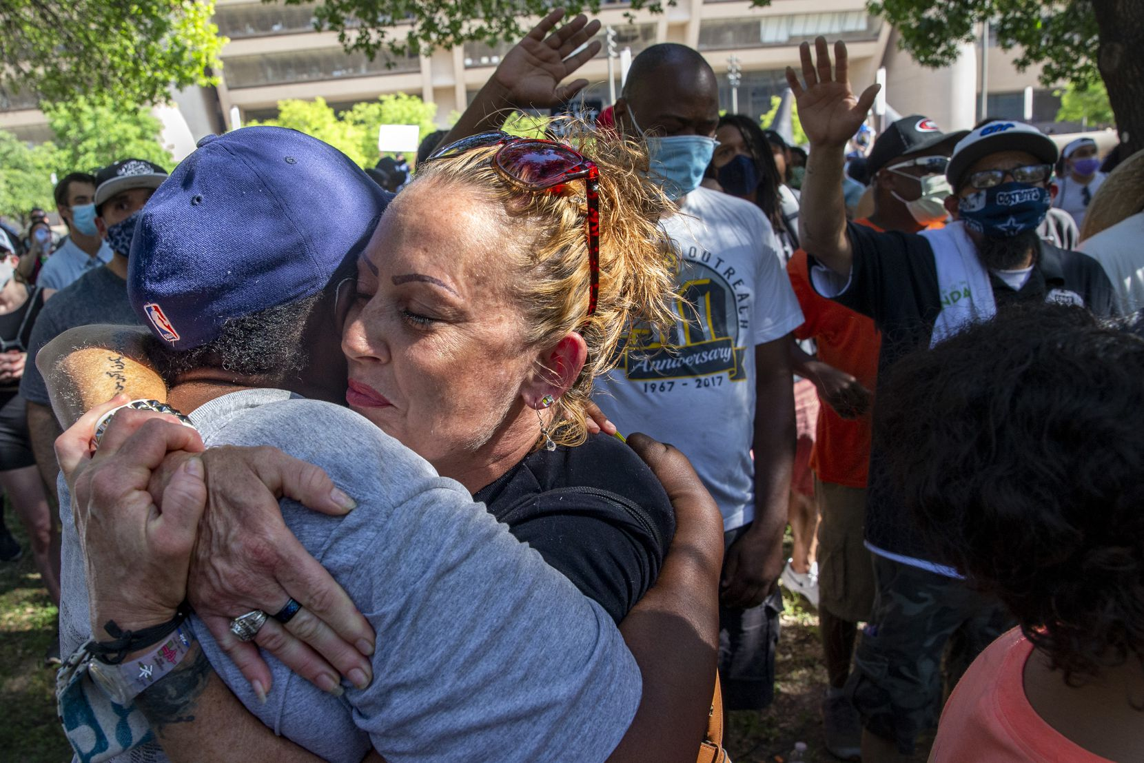 From left, Sharon Offord and Danielle Romero embrace during worship at the Community of Faith Gathering at Dallas City Hall to denounce police brutality and systemic racism in Dallas on Thursday, June 4, 2020. The demonstration took place on the seventh consecutive day of organized protests in response to the recent deaths of George Floyd in Minneapolis and Breonna Taylor in Louisville.