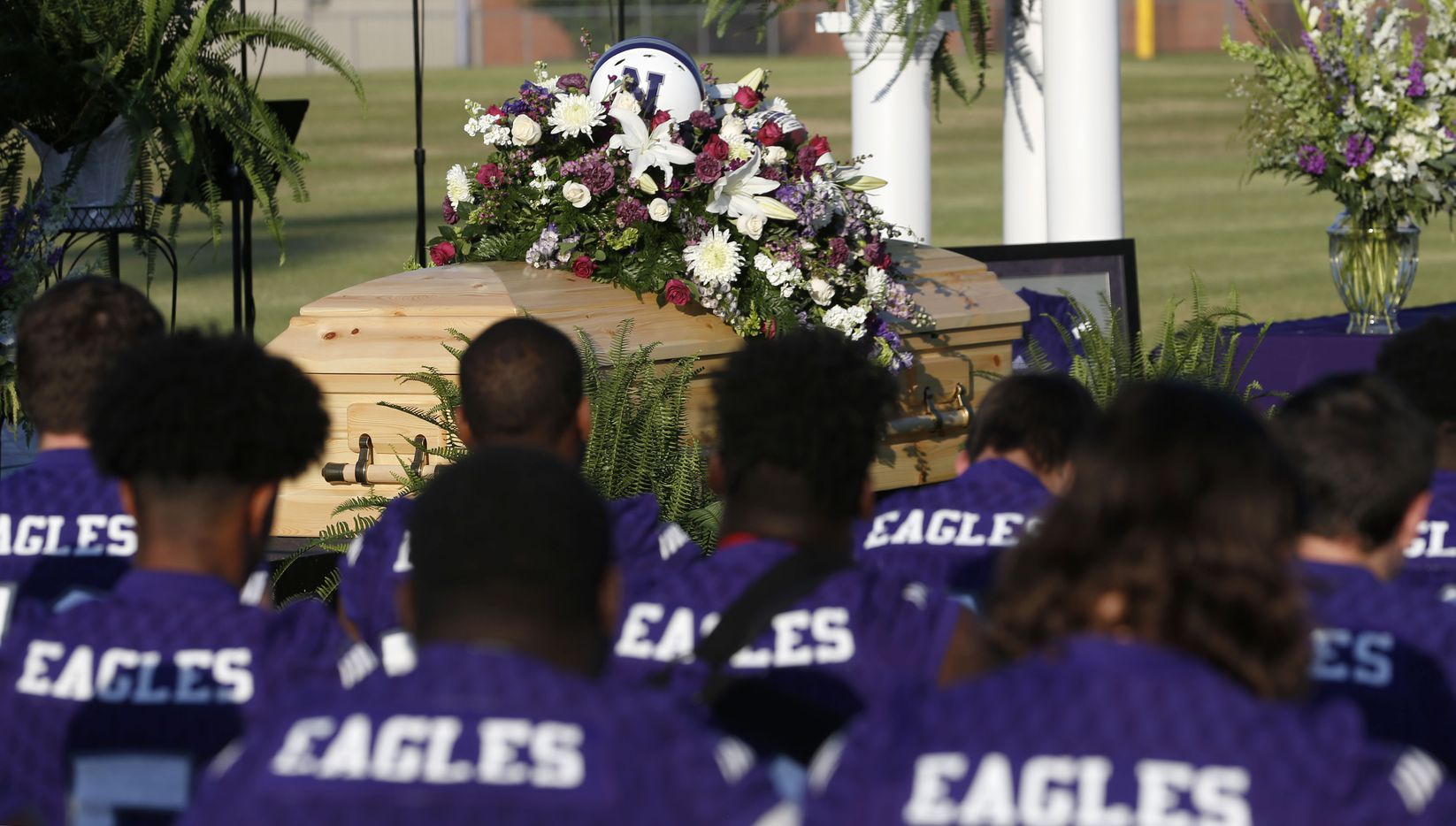 """Newton High School football team in attendance for their  head football coach William Theodore """"W.T."""" Johnston's memorial service at Curtis Barbay Field at Newton High School in Newton, Texas on Wednesday, May 15, 2019. The team won state football championships in 2017 and 2018. (Vernon Bryant/The Dallas Morning News)"""