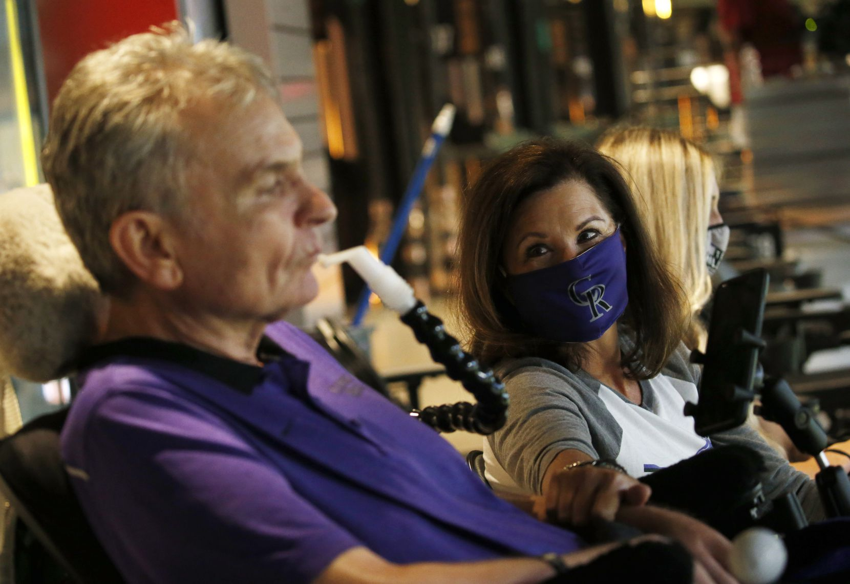 Jim Hilliard with his wife Tamara Hillard and Kat Minnerly watch as their son Colorado Rockies right fielder Sam Hilliard (43) is up at bat in the opening day game between the Texas Rangers and Colorado Rockies at Globe Life Field in Arlington, Texas on Friday, July 24, 2020. Minnerly is the fiancée to Sam Hilliard.