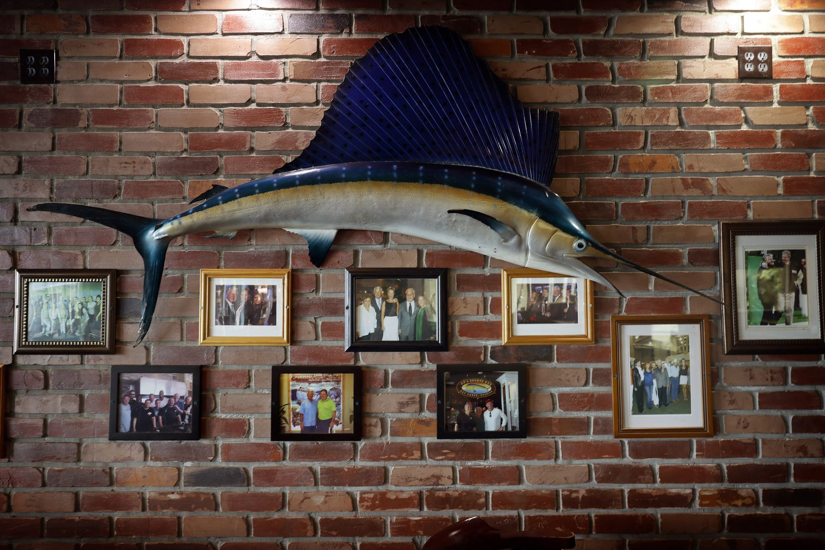 NFL Hall of Fame inductee Jimmy Johnson hung photos of friends in his Big Chill at Fisherman's Cove restaurant in Key Largo, Fla. The former Dallas Cowboys head coach and current FOX NFL SUNDAY analyst was voted into the 2020 Hall of Fame class and will be inducted in Canton this summer.