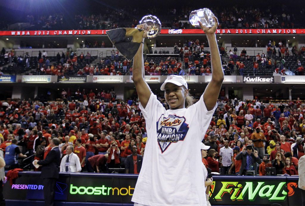 Indiana Fever forward Tamika Catchings celebrates with the trophy and the MVP award after winning the WNBA basketball Finals against the Minnesota Lynx in Indianapolis, Sunday, Oct. 21, 2012. The Fever won 87-78 to clinch their first WNBA championship.