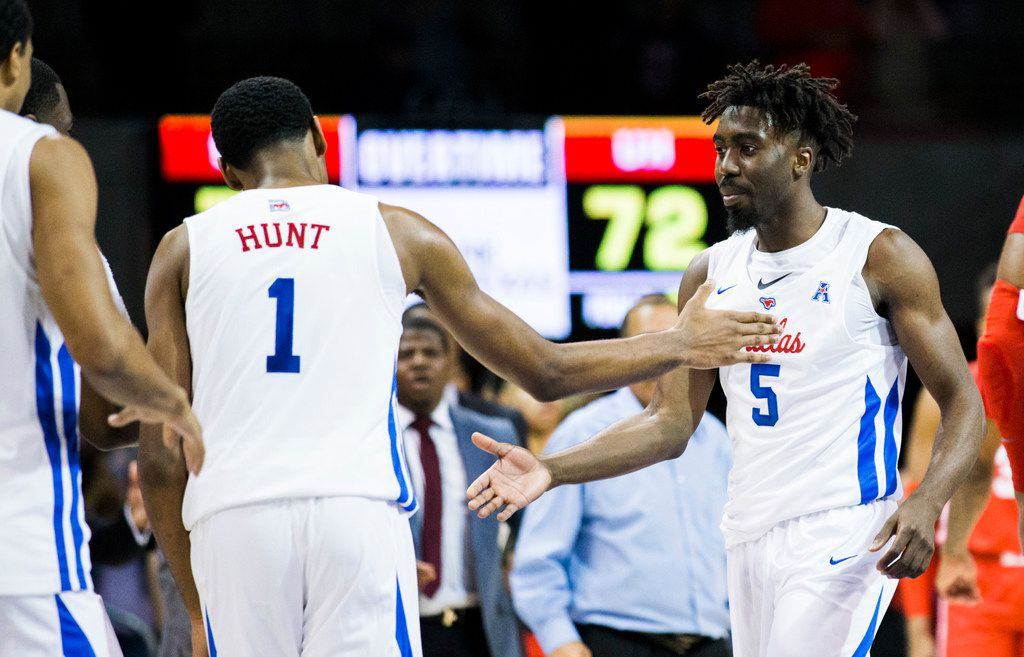 Southern Methodist Mustangs guard Emmanuel Bandoumel (5) gets a high-five from forward Feron Hunt (1) after a three pointer in overtime of a basketball game between SMU and University of Houston on Saturday, February 15, 2020 at Moody Coliseum in Dallas. (Ashley Landis/The Dallas Morning News)