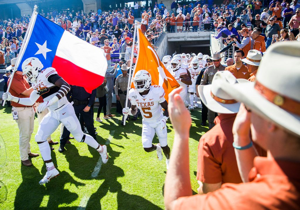 Texas Longhorns enter the field before an NCAA football game between the University of Texas and TCU on Saturday, October 26, 2019 at Amon G Carter Stadium in Fort Worth. (Ashley Landis/The Dallas Morning News)