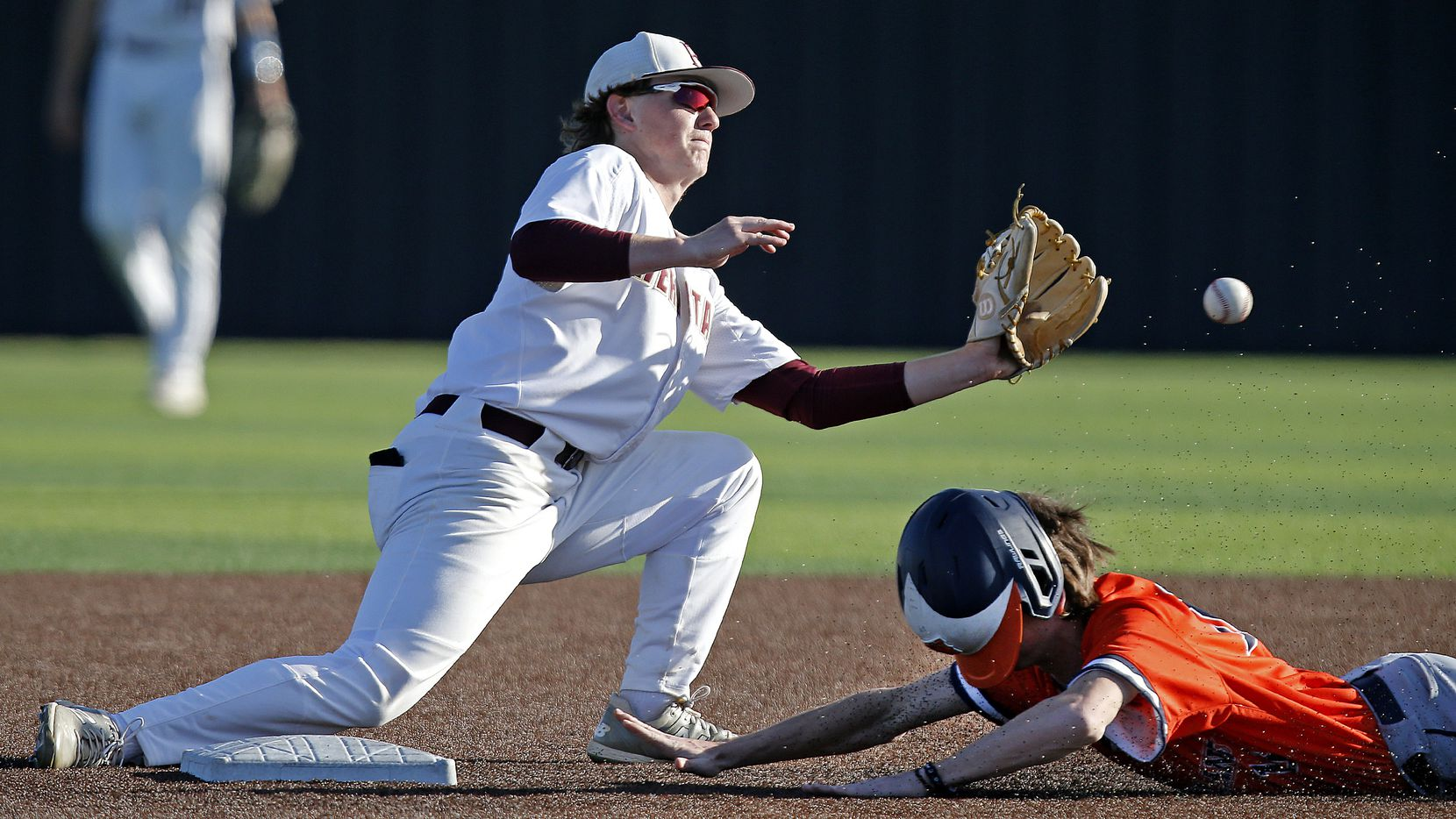 Frisco Heritage second baseman Gehrig Butz can't put the tag on Frisco Wakeland's Cooper Huff as he steals second base in the sixth inning of Wakeland's 9-0 victory.