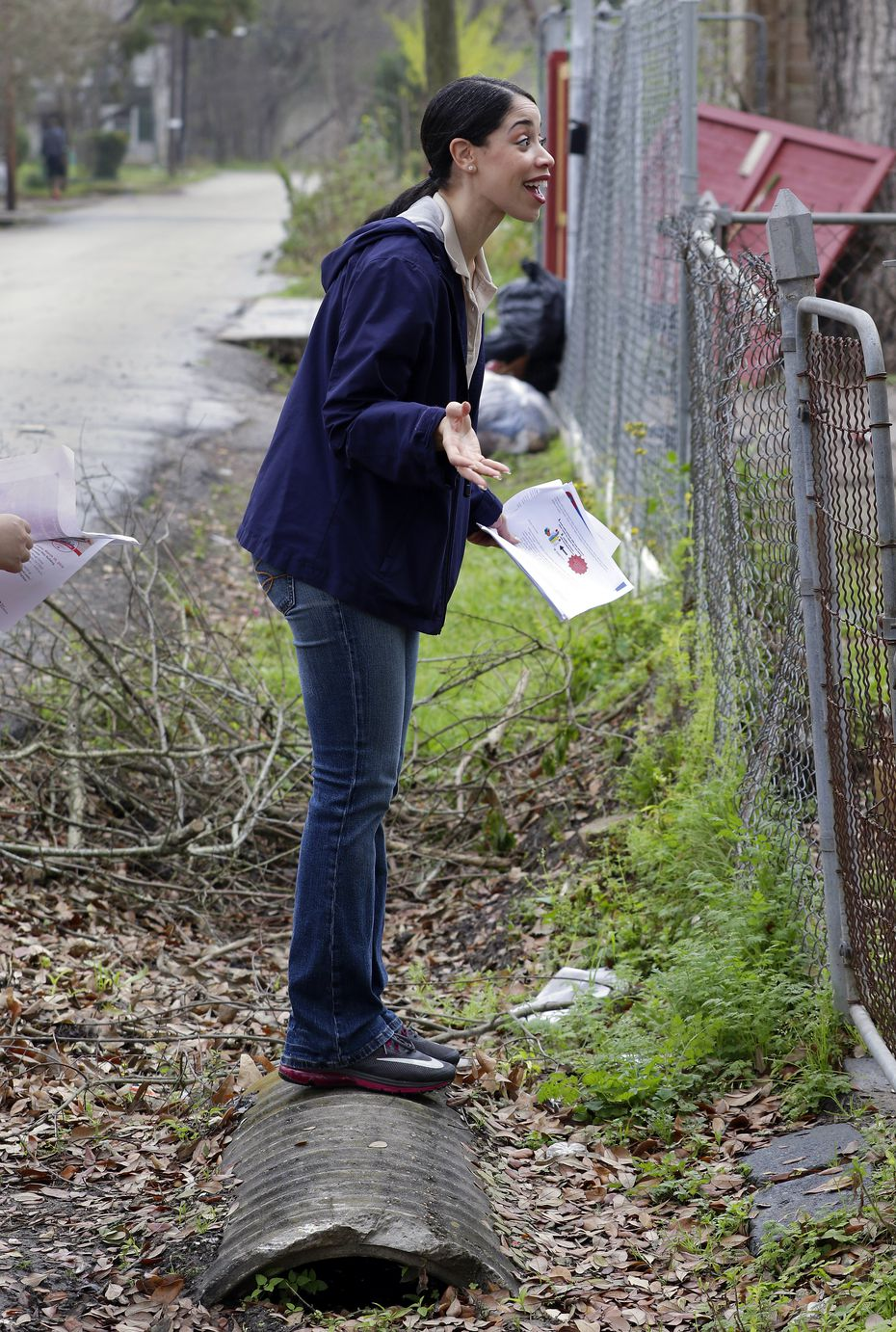 Houston City Council member Amanda Edwards talks with a resident affected by the floods of Hurricane Harvey in the Kashmere Gardens neighborhood Feb. 23.