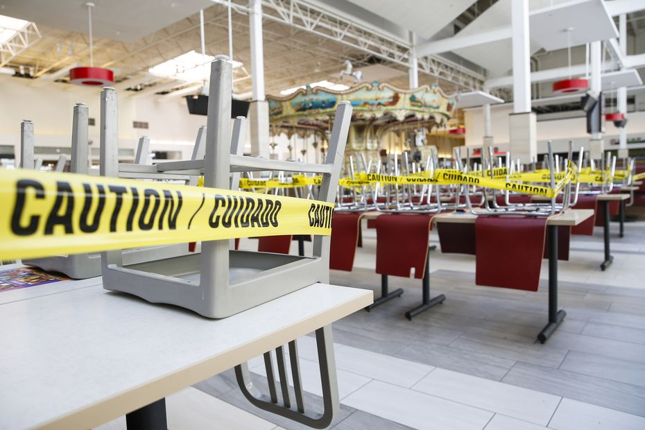 Wrapped in caution tape, the sit-in dining area of the food court was closed Friday at Grapevine Mills mall.
