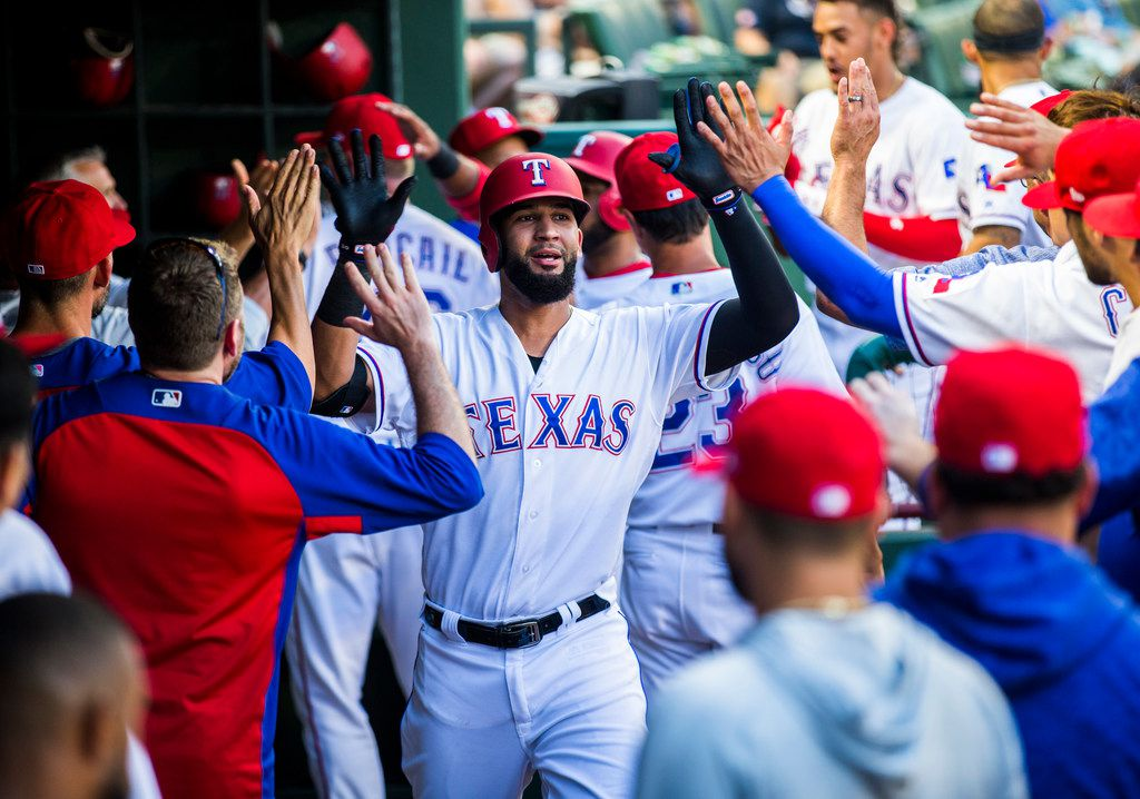 Texas Rangers right fielder Nomar Mazara (30) gets high-fives in the dugout after a home run hit during the first inning of an MLB game between the Texas Rangers and the Los Angeles Angels on Thursday, August 16, 2018 at Globe Life Park in Arlington. (Ashley Landis/The Dallas Morning News)