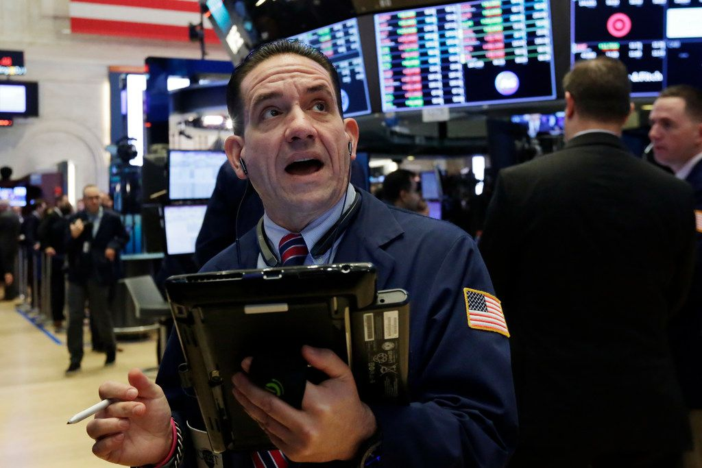 Trader Tommy Kalikas works on the floor of the New York Stock Exchange, Monday, Nov. 6, 2017. Stocks are little changed in early trading as technology and energy companies move higher, but phone companies slip. (AP Photo/Richard Drew)
