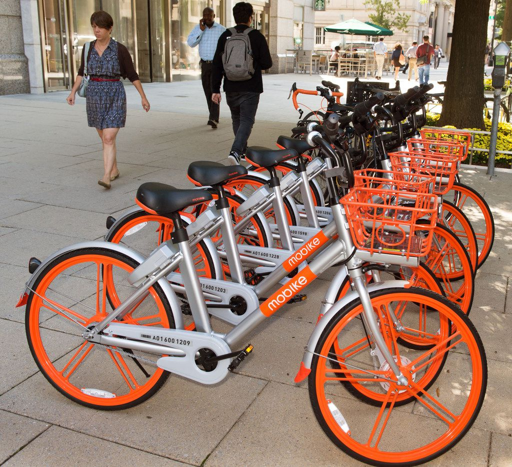 Mobikes are seen on the streets of Washington, D.C. The Chinese bike-sharing giant Mobike on Wednesday launched in Dallas, but decided to leave the market.
