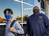 "Plumbing instructor Merv Scurlark (right) and freshman aviation student Israel Olivares pose for a photo at the Career Institutes South campus in Dallas on  Nov. 20, 2020. This fall marked the opening of three DISD Career Institutes -- centralized facilities designed to give students hands-on experience in industries like plumbing, cybersecurity and construction. But with the coronavirus pandemic raging, fulfilling the promise of that hands-on training became much more complicated. Scurlark said the pandemic has affected the number of students that would normally enroll in his classes, but that he's hopeful the interest would return post-pandemic. ""It's good, honest work that provides a lot of opportunity after high school,"" he said. (Lynda M. González/The Dallas Morning News)"