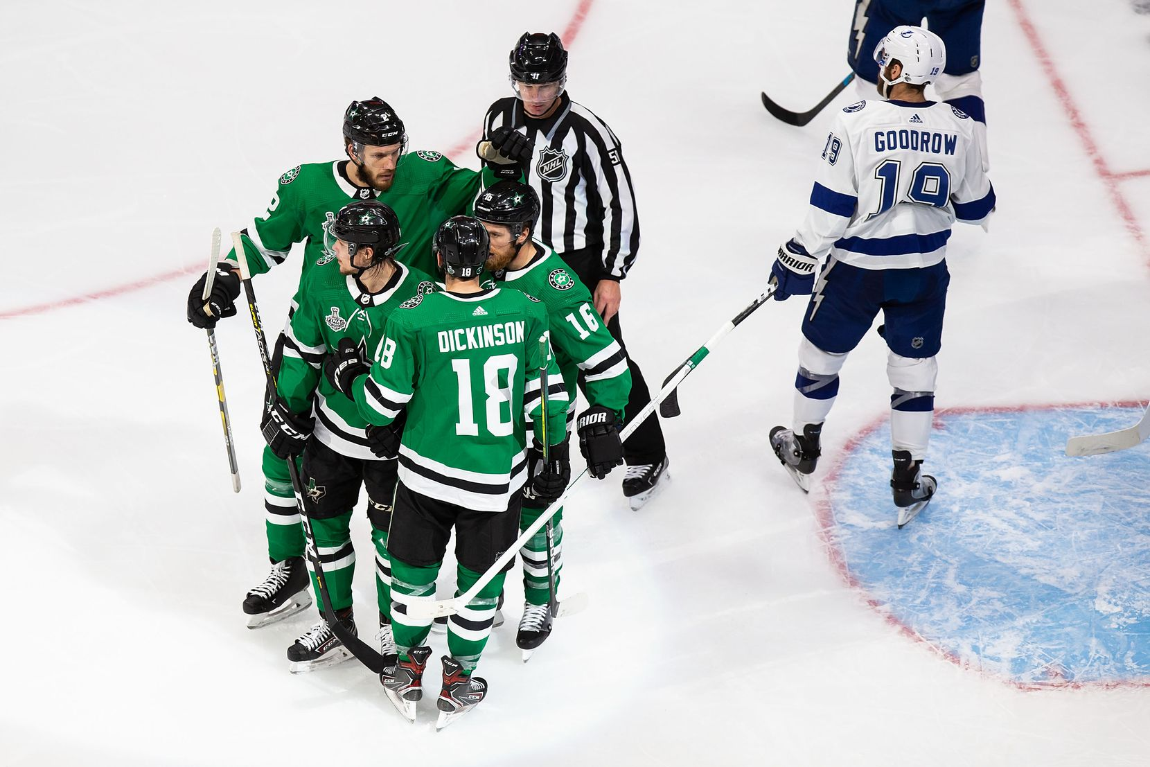 Jamie Oleksiak (2), Miro Heiskanen (4), Jason Dickinson (18) and Joe Pavelski (16) of the Dallas Stars celebrate Heiskanen's goal against the Tampa Bay Lightning during Game Three of the Stanley Cup Final at Rogers Place in Edmonton, Alberta, Canada on Wednesday, September 23, 2020. (Codie McLachlan/Special Contributor)