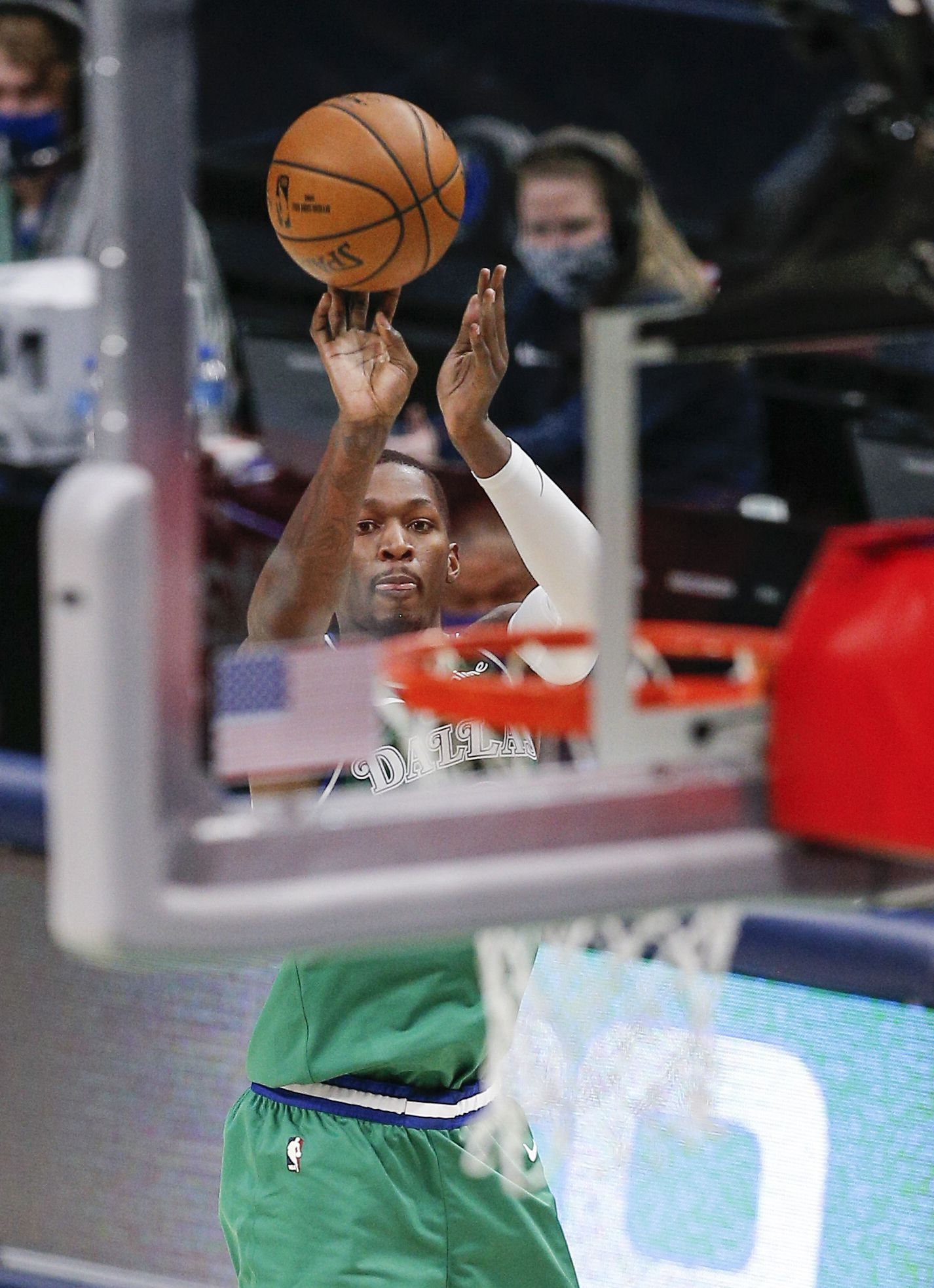 Dallas Mavericks forward Dorian Finney-Smith (10) attempts a shot during the second half of an NBA basketball game against the Phoenix Suns in Dallas, Saturday, January 30, 2021. Phoenix won 111-105. (Brandon Wade/Special Contributor)