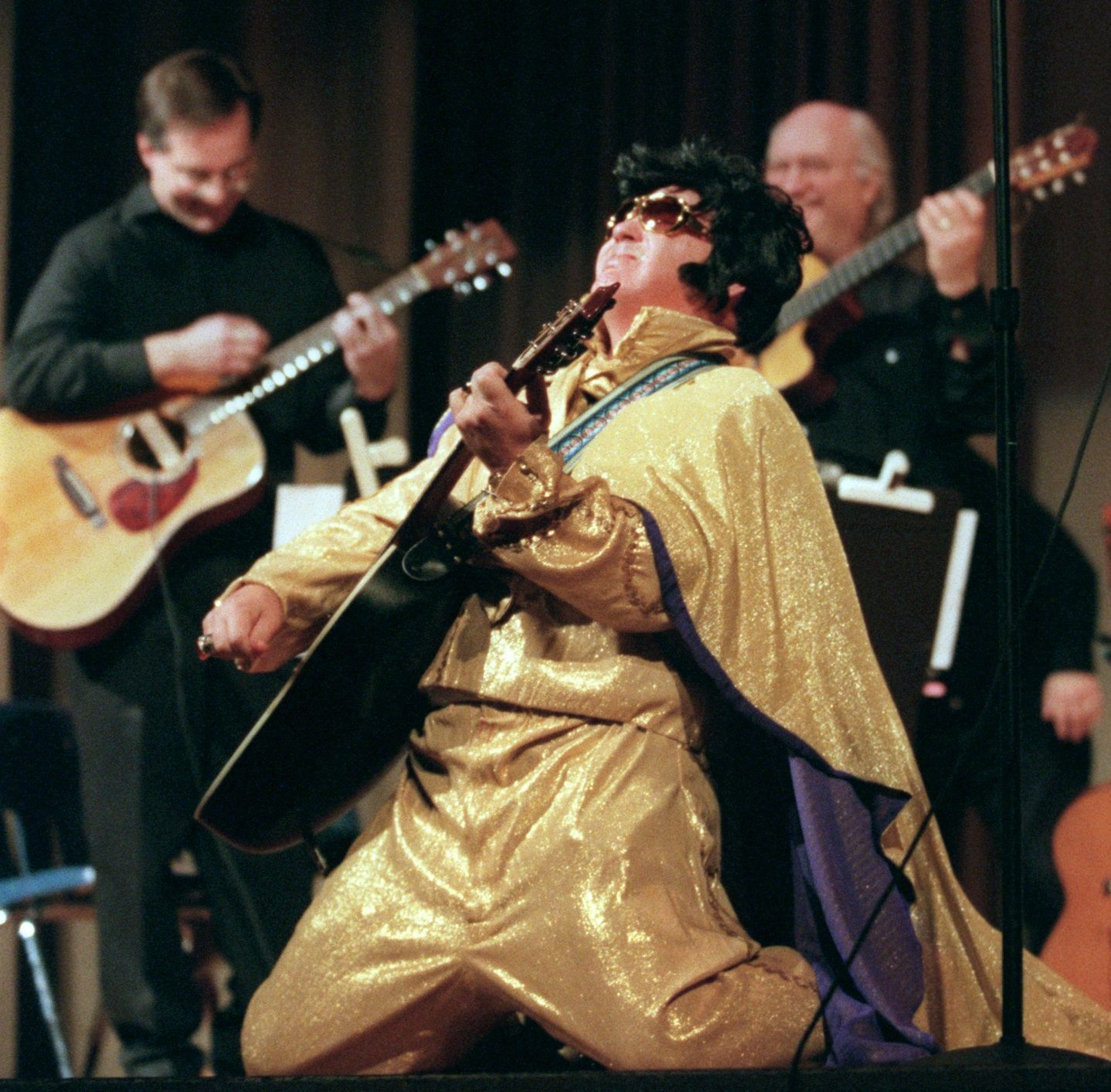 Coach Randy Allen performed an Elvis routine during the first 'HP Unplugged' music variety show featuring school faculty at Highland Park High School.