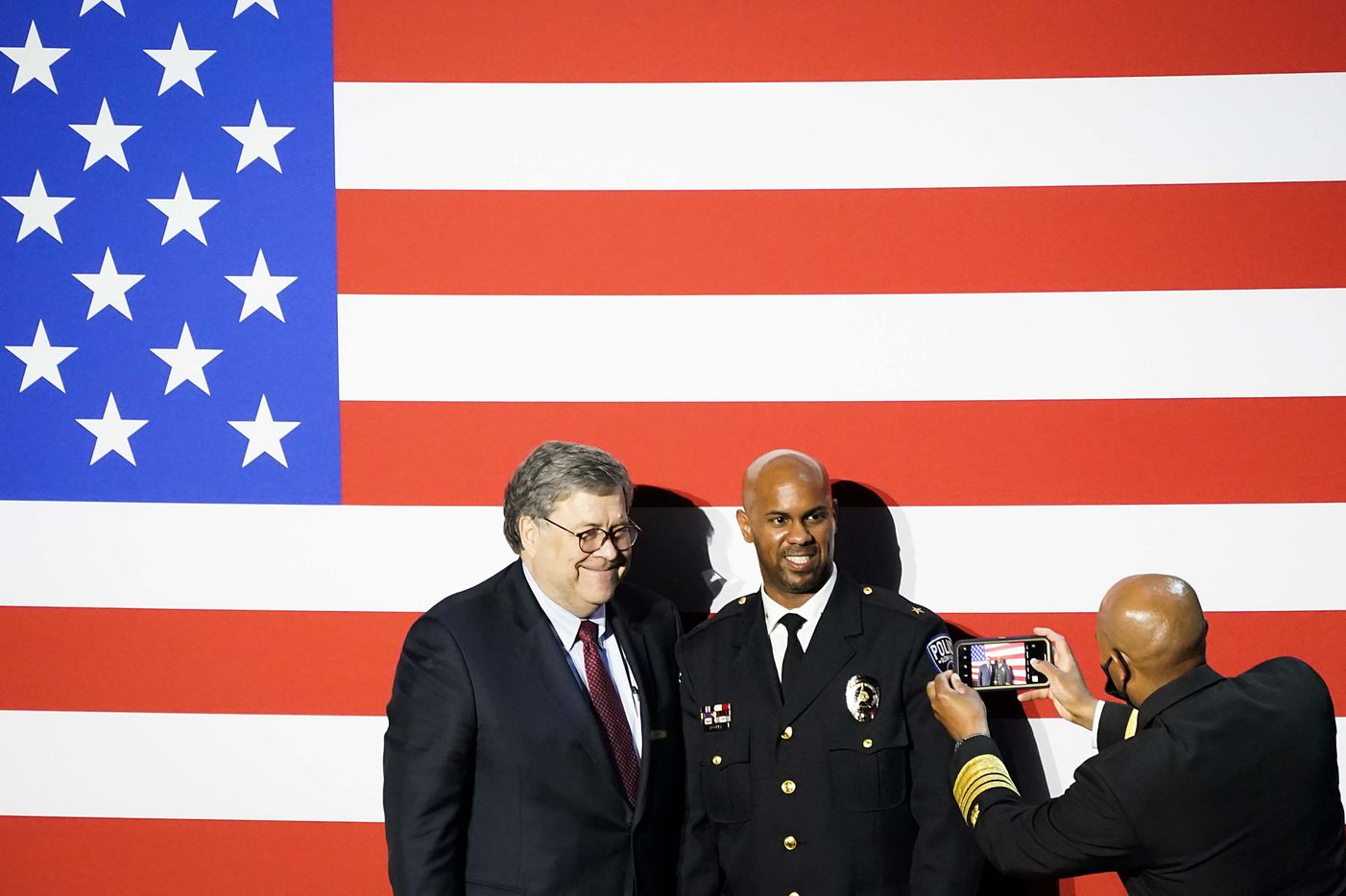 Attorney General William Barr (left) has his photo taken with Glenn Heights Police Chief Vernell Dooley by Surgeon General Jerome Adams after a roundtable conversation about race relations and policing at Gateway Church Dallas Campus on Thursday, June 11, 2020, in Dallas. (Smiley N. Pool/The Dallas Morning News)