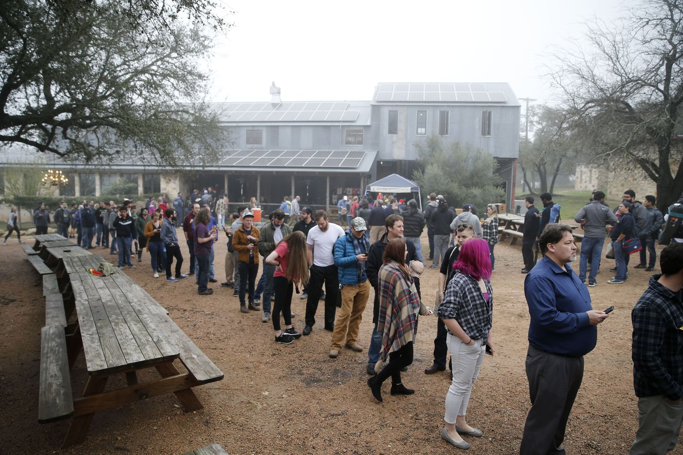 People wait in line to purchase a bottle of Elements of Composition blend 1!, a collaboration with De Garde Brewing and Sante Adairius Rustic Ales at Jester King Brewery in Austin, Texas on Friday, February 23, 2018.