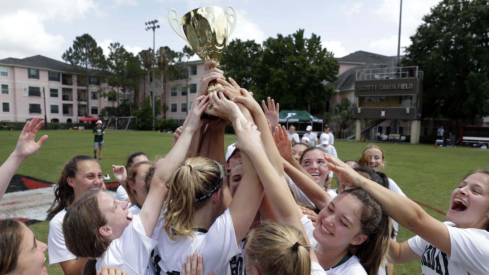 Hockaday players hoist the trophy after their 14-11 win against Southlake Carroll in the Division 1 Texas Girls High School Lacrosse League State Championship game at Scotty Caven Field in Houston, Texas on Sunday, May 9, 2021.
