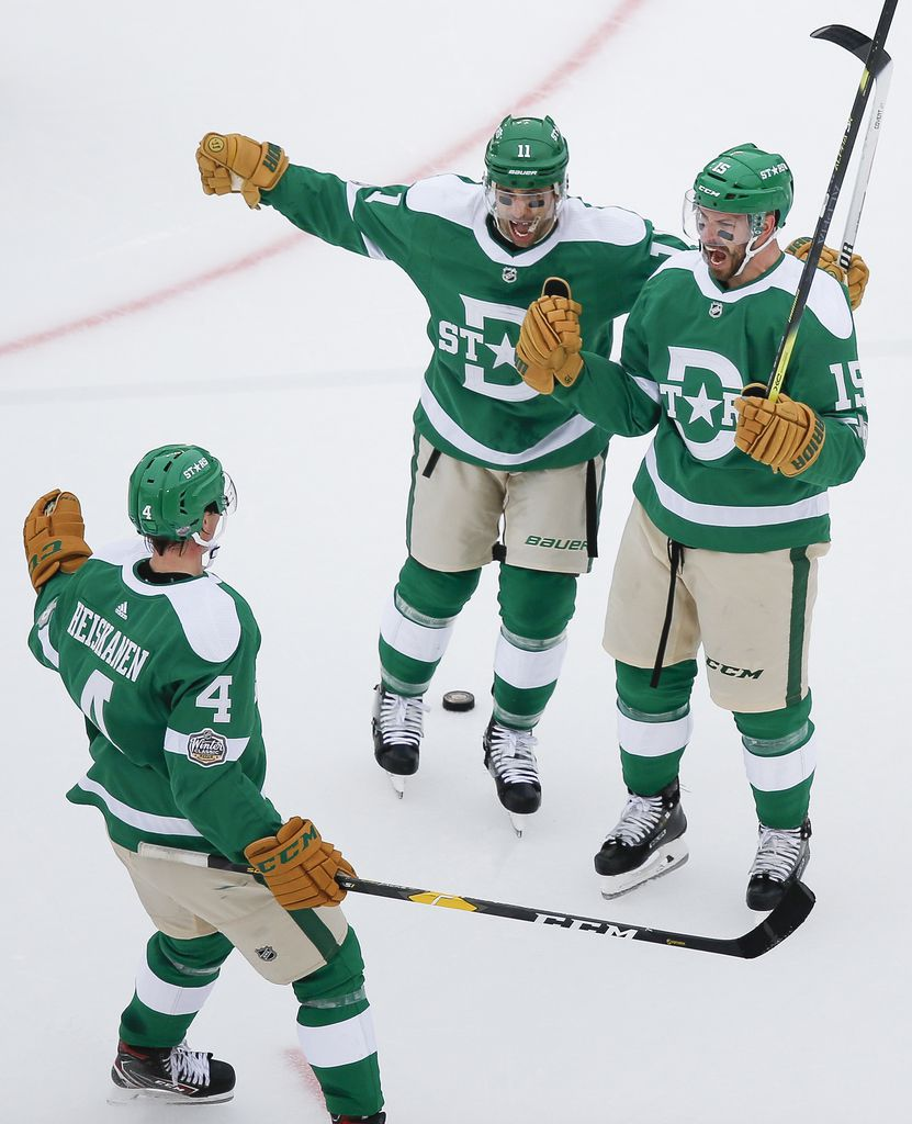 Dallas Stars left wing Blake Comeau (15) celebrates with center Andrew Cogliano (11) and defenseman Miro Heiskanen (4) after scoring during the second period of a NHL Winter Classic matchup between the Dallas Stars and the Nashville Predators on Wednesday, January 1, 2020 at Cotton Bowl Stadium in Dallas. (Ryan Michalesko/The Dallas Morning News)