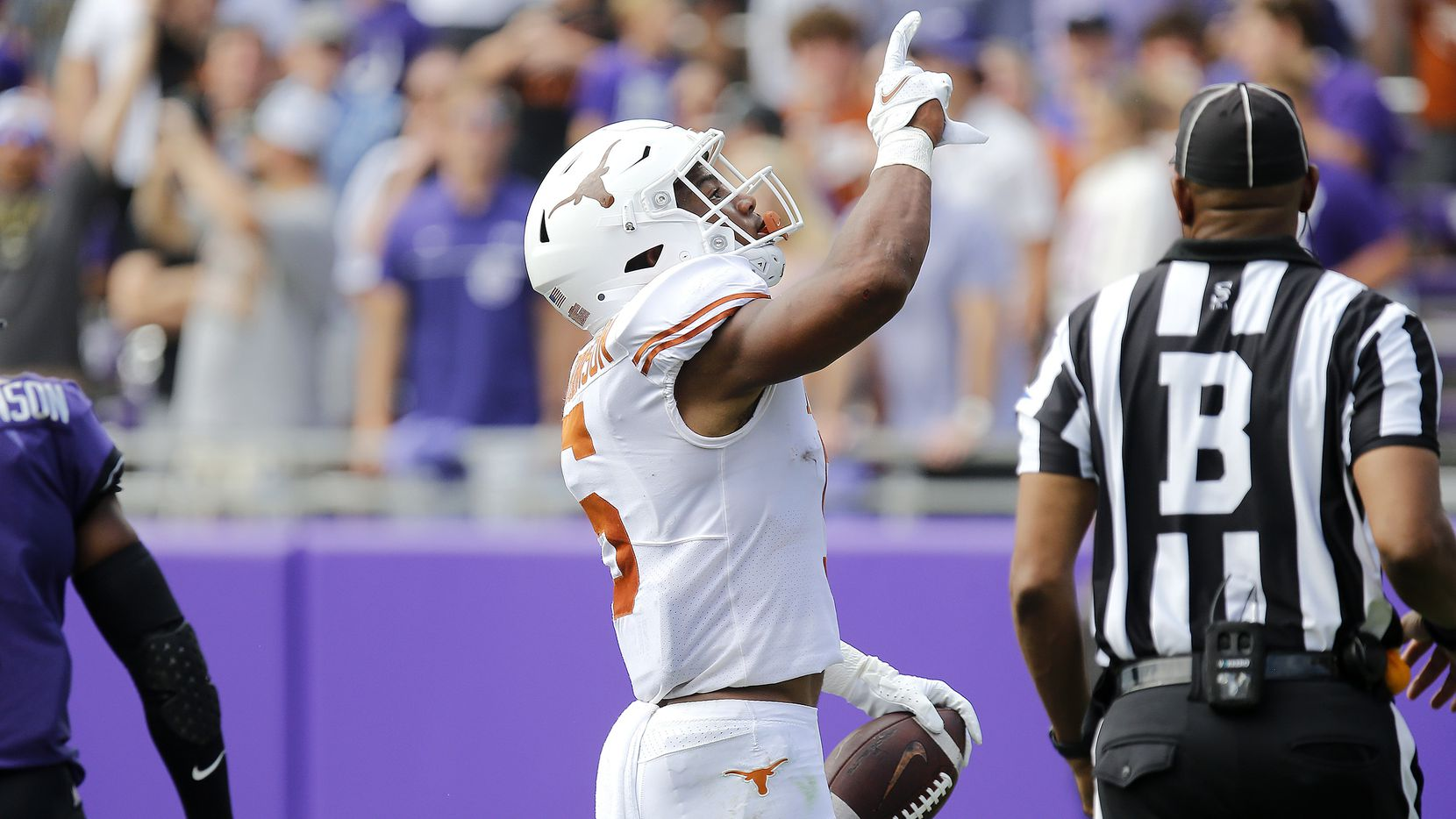Texas Longhorns running back Bijan Robinson (5) celebrates scoring a touchdown during the first half as the TCU Horned Frogs hosted the Texas Longhorns on Saturday, October 2, 2021, at Amon G Carter Stadium in Fort Worth. (Stewart F. House/Special Contributor)