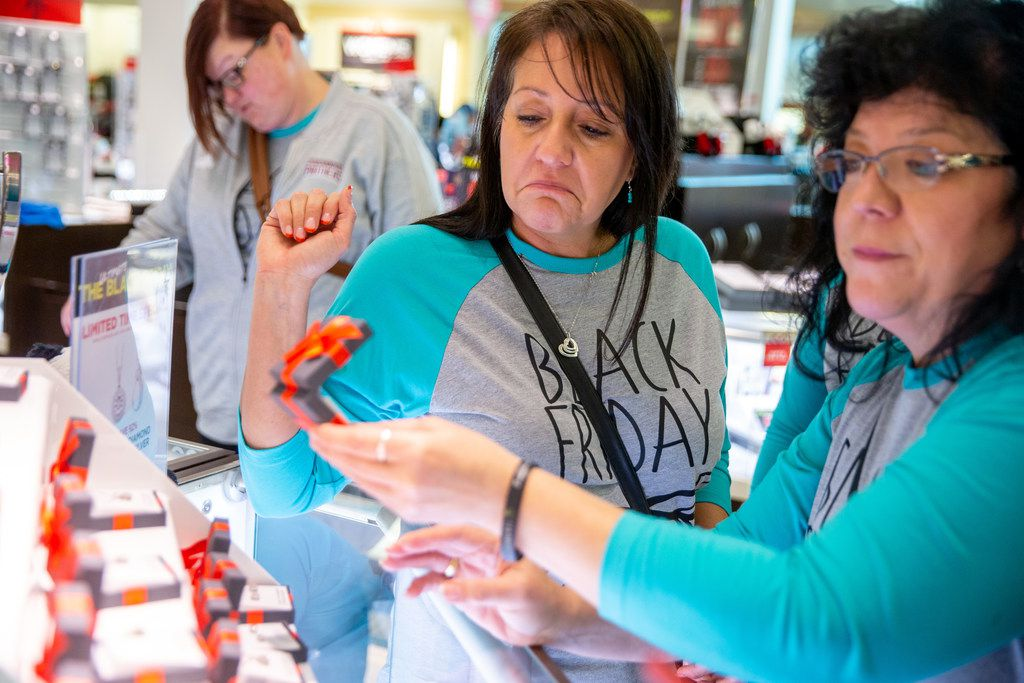 Tamara Powell (left) looks at jewelry with Victoria Barnes during Black Friday shopping at J.C. Penney in Fairview.