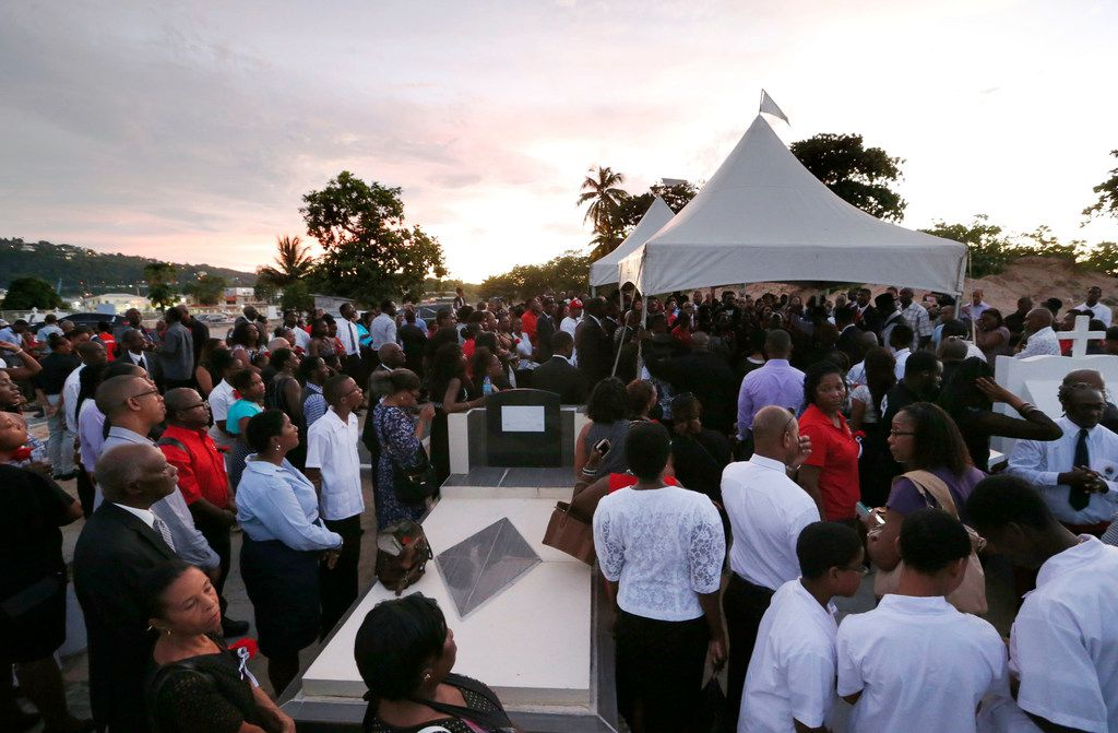 Family, friends, and locals came to the burial of Botham Shem Jean at Choc Cemetery in Castries, St. Lucia on Monday, September 24, 2018. Jean was shot and killed in his apartment by off duty Dallas police officer Amber Guyger. (Vernon Bryant/The Dallas Morning News)