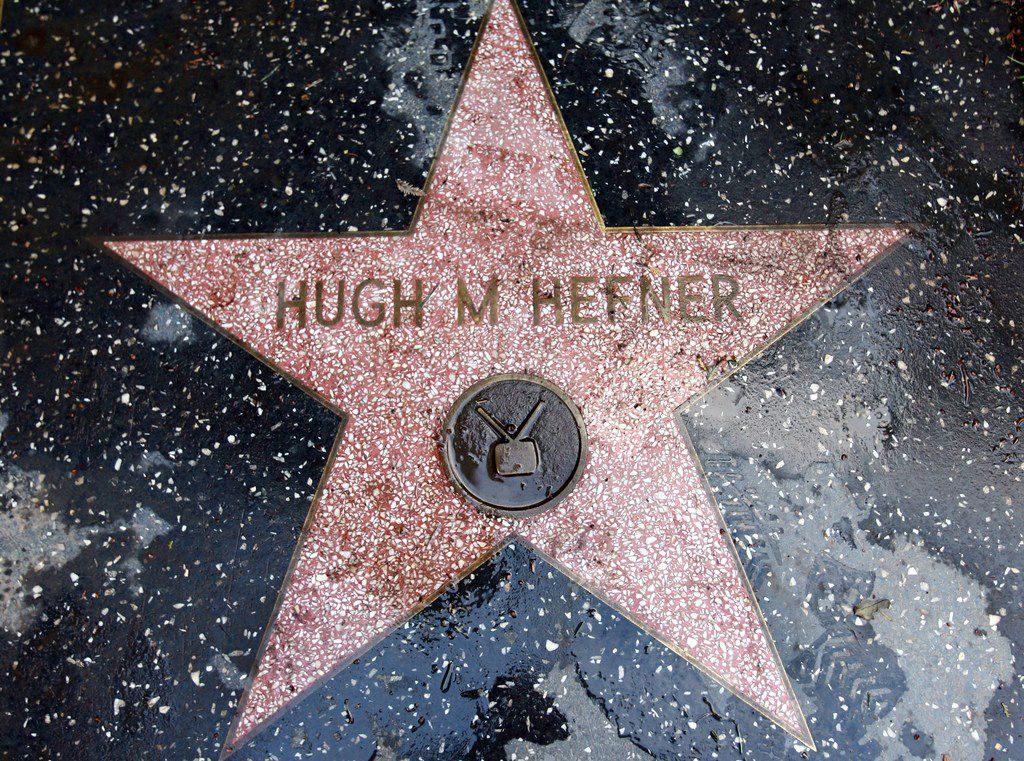 "(FILES) This file photo taken on January 11, 2007 shows a copy of Playboy Magazine publisher Hugh Hefner's ""Star"" from the Hollywood Walk of Fame as seen on Hefner's property, the Playboy Mansion, in Beverly Hills, California.  Hugh Hefner, the silk pajamas-wearing founder of Playboy Magazine who helped steer nudity into the American mainstream died Wednesday, September 27, 2017 his magazine announced on Twitter. He was 91 years old."