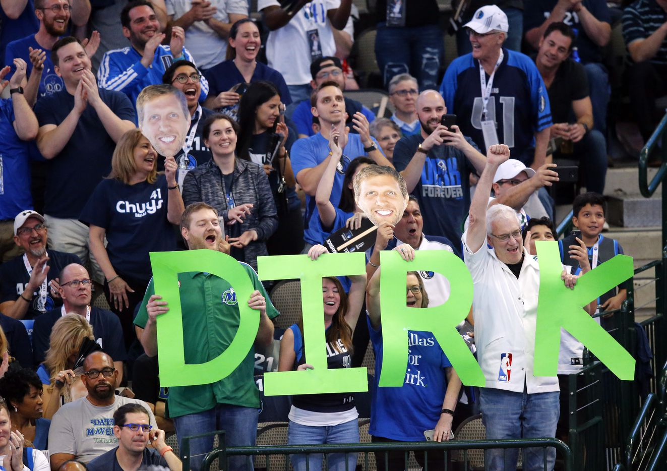 Fans of Dallas Mavericks forward Dirk Nowitzki cheer after he hit a first quarter shot against the Phoenix Suns at the American Airlines Center in Dallas, Tuesday, April 9, 2019. Dirk is playing in his last home game of his 21st season with the team. (Tom Fox/The Dallas Morning News)
