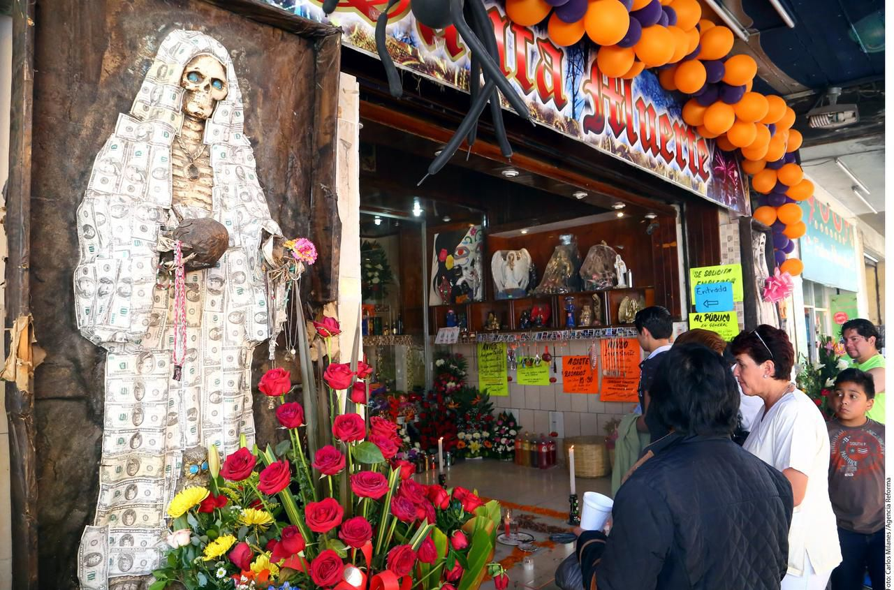 A Santa Muerte altar in Mexico City. La Santa Muerte is an underworld folk saint associated with the violent drug trade in Mexico. Altars with her image have been found in many drug houses in Mexico and the U.S. For superstitious drug traffickers, she is invoked in an attempt to protect drug shipments. Women who have traditionally served a minor role in Latin American narcotics conspiracies are increasingly taking on leadership positions, as two recent indictments in North Texas illustrate.