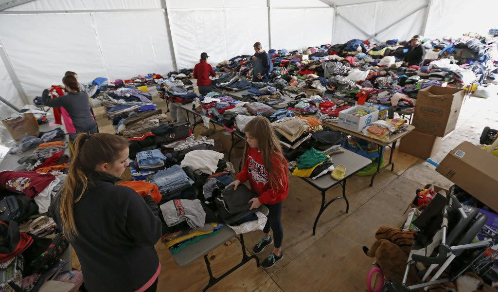 Volunteers set up to receive donations for victims of the December 2015 tornado in the annex at Granger Recreation Center in Garland. Dallas County used the rec center as the site of its Joint Disaster Management Resource Center.
