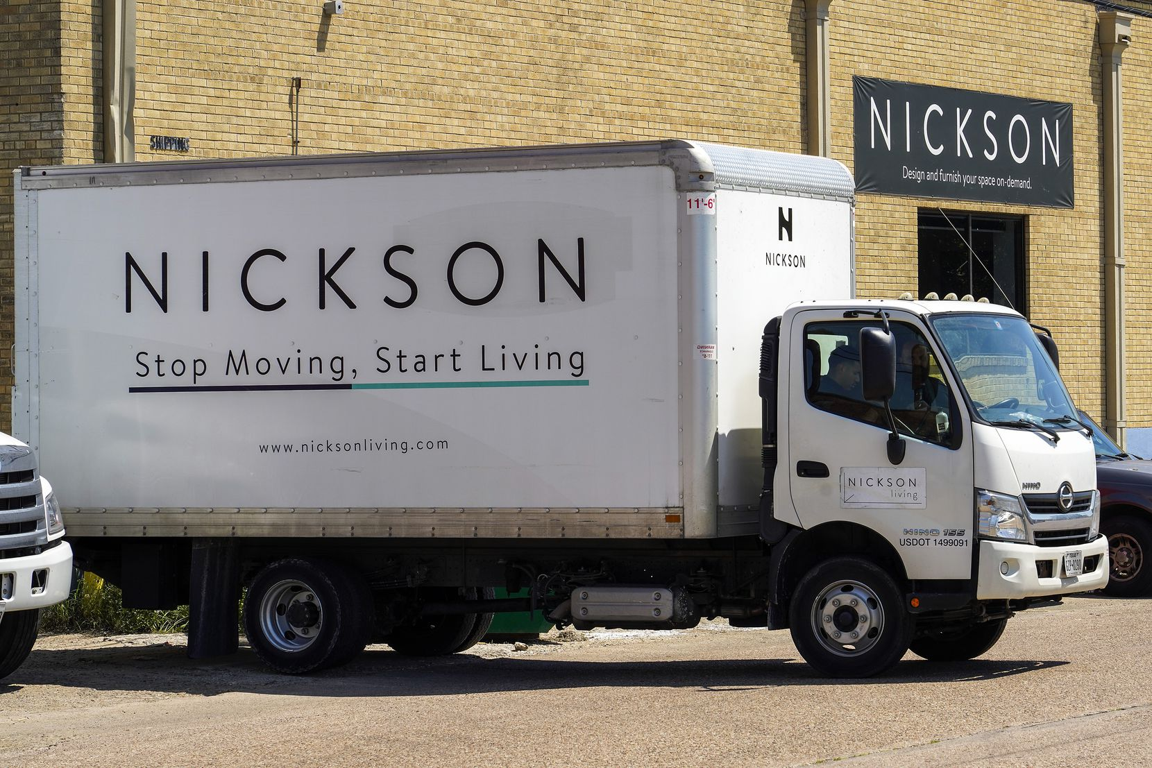 A delivery truck pulls up to the loading docks of the Nickson Furnished offices.