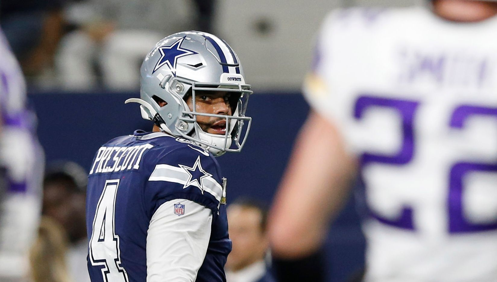 Dallas Cowboys quarterback Dak Prescott (4) and Minnesota Vikings outside linebacker Anthony Barr (55) share words after the Cowboys were stopped on third down during the second half of play at AT&T Stadium in Arlington, Texas on Sunday, November 10, 2019.
