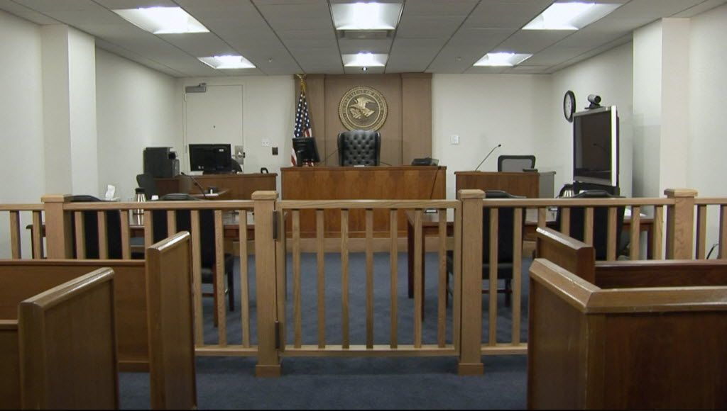 Federal Immigration court room in Arlington, Texas. Frame grab from video.