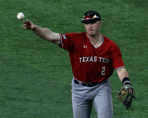 Texas Tech 2nd baseman Jace Jung (2) throws out an Ole Miss batter after fielding a ground ball during the bottom of the first inning. Texas Tech played Ole Miss in conjunction with the State Farm College Baseball Showdown tournament held at Globe Life Field in Arlington on February 21, 2021. (Steve Hamm/ Special Contributor)