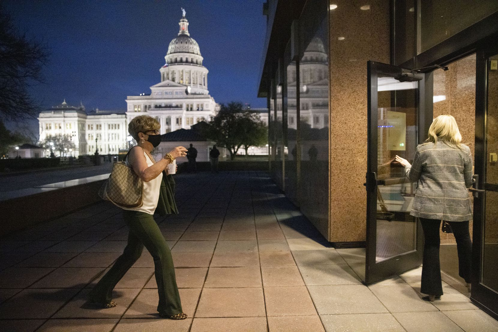 Cheryl Pangburn holds the door for Shannon Dion as they enter Austin's John H. Reagan State Office Building, near the Capitol, to testify before the House Committee on Public Health on Wednesday.
