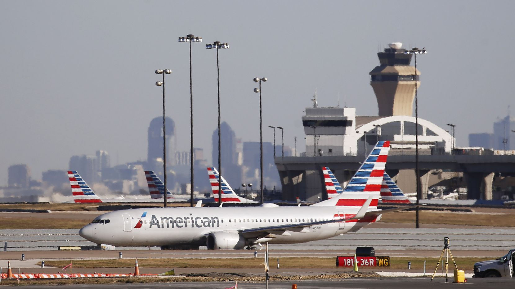 An American Airlines plane makes its way toward the runway before taking off at DFW International Airport on Monday, November 16, 2020.