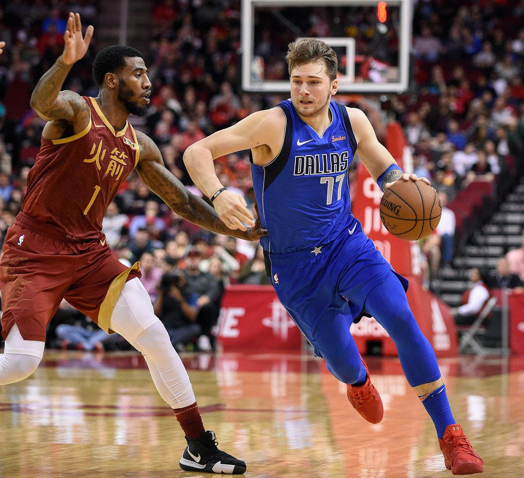 Dallas Mavericks forward Luka Doncic, right, drives as Houston Rockets guard Iman Shumpert defends during the first half of an NBA basketball game, Monday, Feb. 11, 2019, in Houston. (AP Photo/Eric Christian Smith)