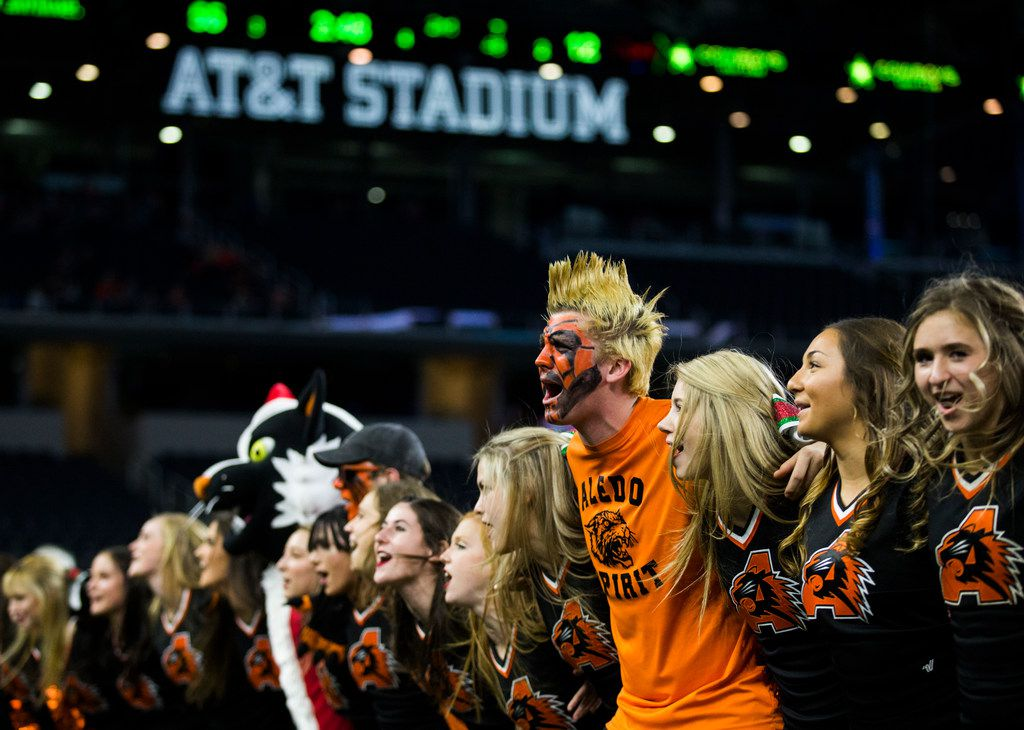 Aledo cheerleaders cheer on the sideline during the fourth quarter of a UIL Class 5A Division II football state championship game between Aledo and Fort Bend Marshall on Friday, December 21, 2018 at AT&T Stadium in Arlington. (Ashley Landis/The Dallas Morning News)