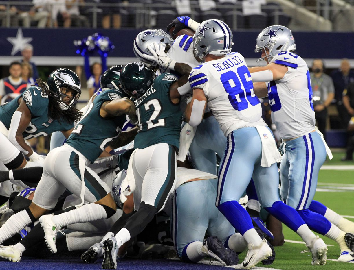Dallas Cowboys running back Ezekiel Elliott (21) score the Cowboys' first touchdown during the first half of a NFL football game between the Dallas Cowboys and the Philadelphia Eagles High at AT&T Stadium in Arlington on Monday, September 27, 2021. (John F. Rhodes / Special Contributor)