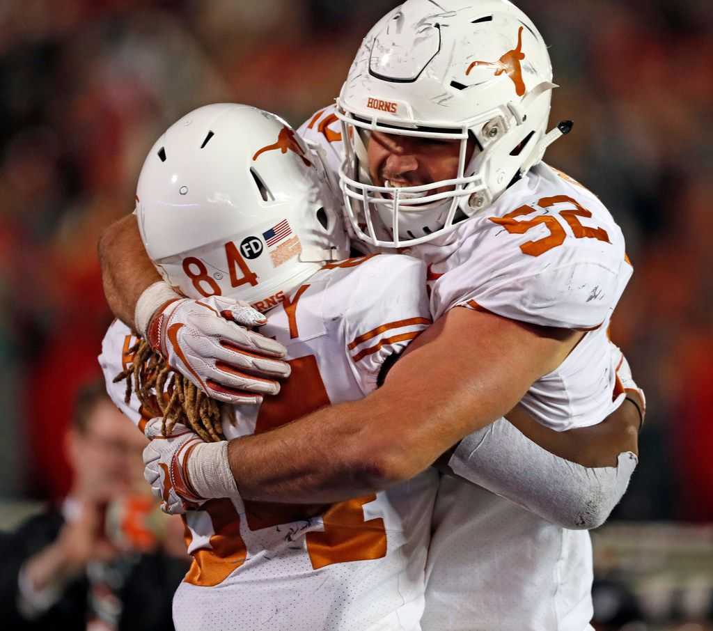 Texas' Lil'Jordan Humphrey (84) celebrates with Samuel Cosmi (52) after scoring the go-ahead touchdown during the second half of an NCAA college football game against Texas Tech, Saturday, Nov. 10, 2018, in Lubbock, Texas.