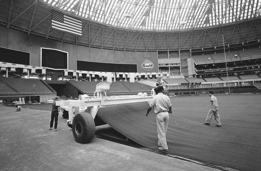 This is a 1966 file photo showing artificial turf being installed at the Astrodome in Houston.