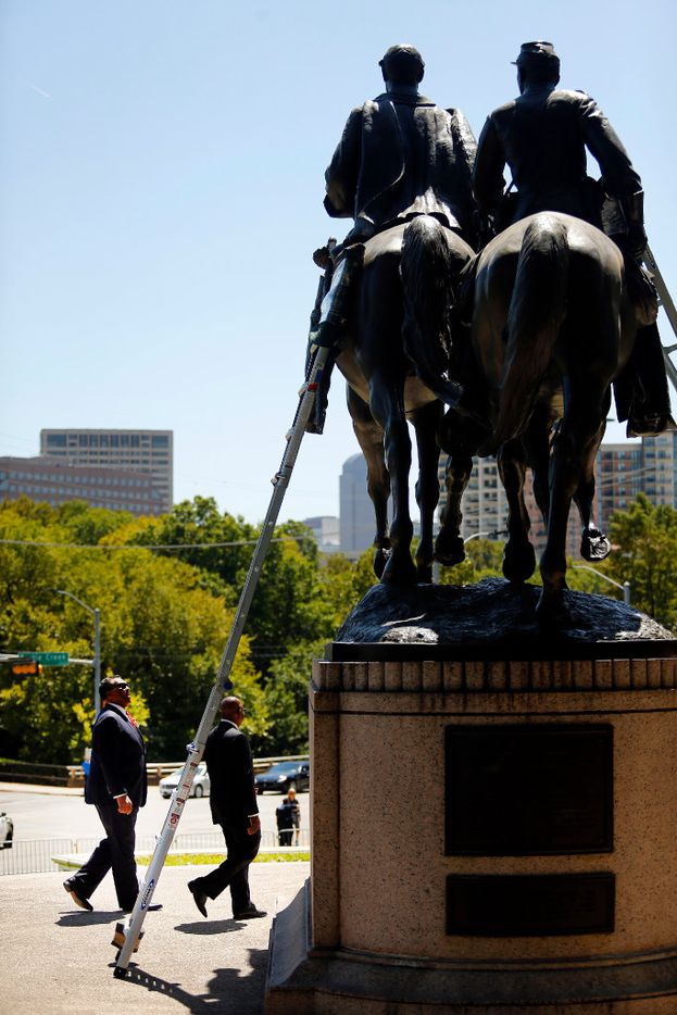 Dallas City Council member Dwaine Caraway (left) came to see the Robert E. Lee statue Wednesday before the attempt to remove it from Lee Park in Dallas.
