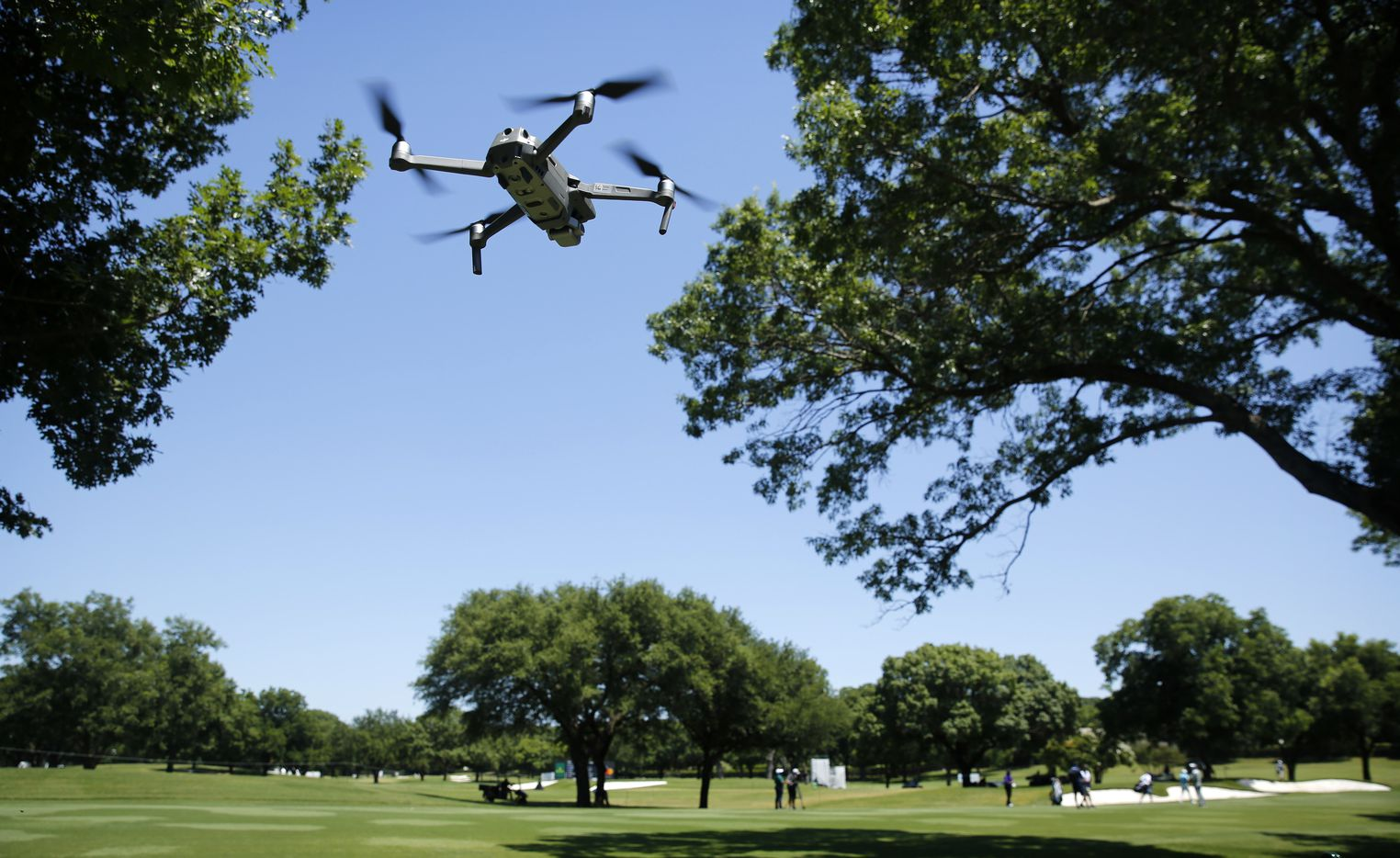A drone films PGA Tour golfer and leader Jordan Spieth during the third round of the Charles Schwab Challenge at the Colonial Country Club in Fort Worth, Saturday, June 13, 2020.  The Challenge is the first tour event since the COVID-19 pandemic began. (Tom Fox/The Dallas Morning News)