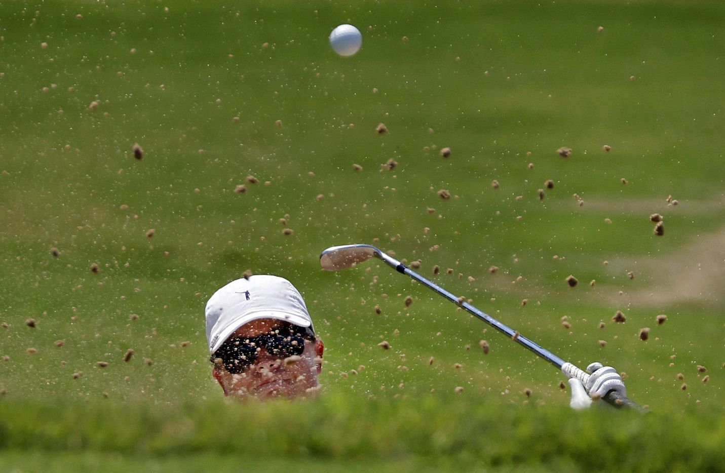Professional golfer Lauren Coughlin attempts to hit her ball out of the green side bunker on No. 17 during the opening round of the LPGA VOA Classic at the Old American Golf Club in The Colony, Texas, Thursday, July 1, 2021. Her second attempt landed on the green. (Tom Fox/The Dallas Morning News)