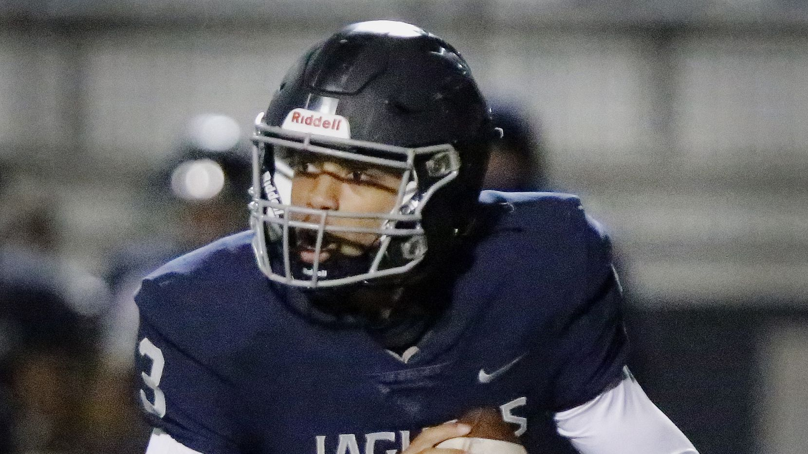 Flower Mound High School quarterback Nick Evers (3) rolls out of the pocket during the first half as Flower Mound High School hosted Flower Mound Marcus High School at Neal E. Wilson Jaguar Stadium on Friday night, October 23, 2020.