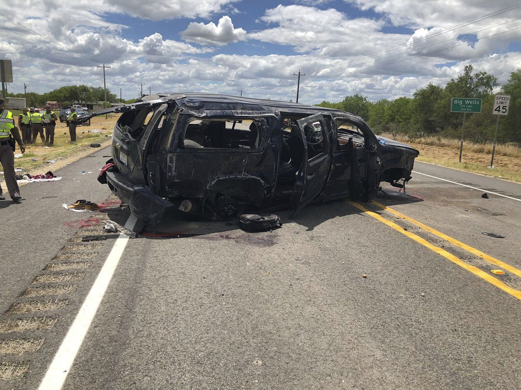 A heavily damaged SUV is seen on Texas Highway 85 in Big Wells, Texas, after crashing while carrying more than a dozen people fleeing from Border Patrol agents in June 2018.