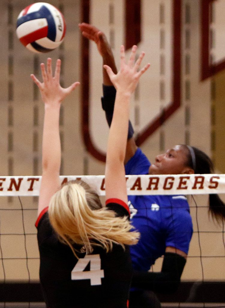Trophy Club Byron Nelson Charitie Luper (10) drops a shot over the defense of Coppell defender Peyton Minyard (4) during the second game of their match. Byron Nelson won in straight sets, 25-14, 25-21, 25-11. The two teams played their first-round Class 6A volleyball playoff match at Keller Central High School in Fort Worth on November 5, 2019. (Steve Hamm/ Special Contributor)