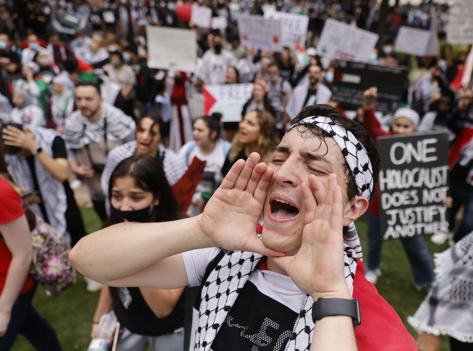 """Demonstrators at Sunday's """"Rise Up for Palestine"""" event rallied at Belo Garden on Dallas' Main Street before marching through downtown."""