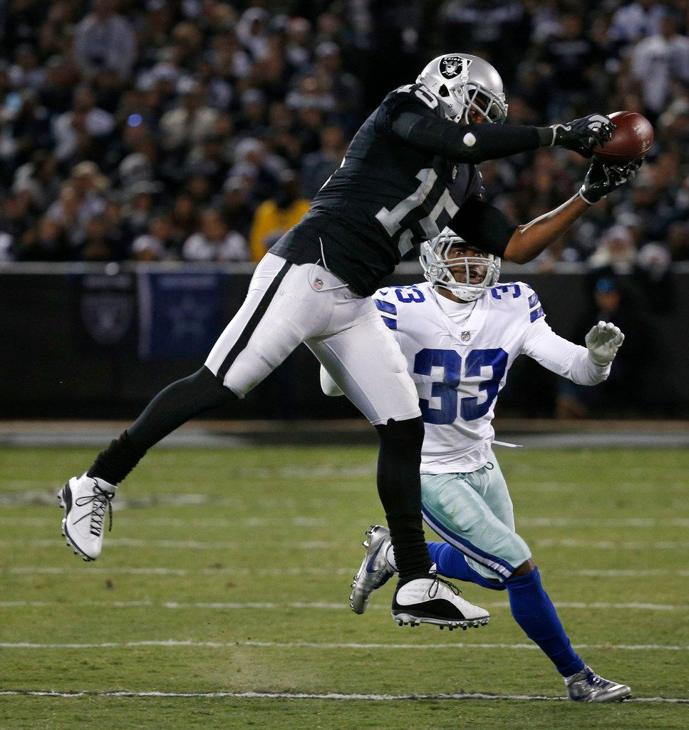 Oakland Raiders wide receiver Michael Crabtree (15) makes a catch against Dallas Cowboys cornerback Chidobe Awuzie (33) in the second quarter at Oakland Alameda County Coliseum in Oakland, California on Sunday, Dec. 17, 2017. (Rose Baca/The Dallas Morning News)