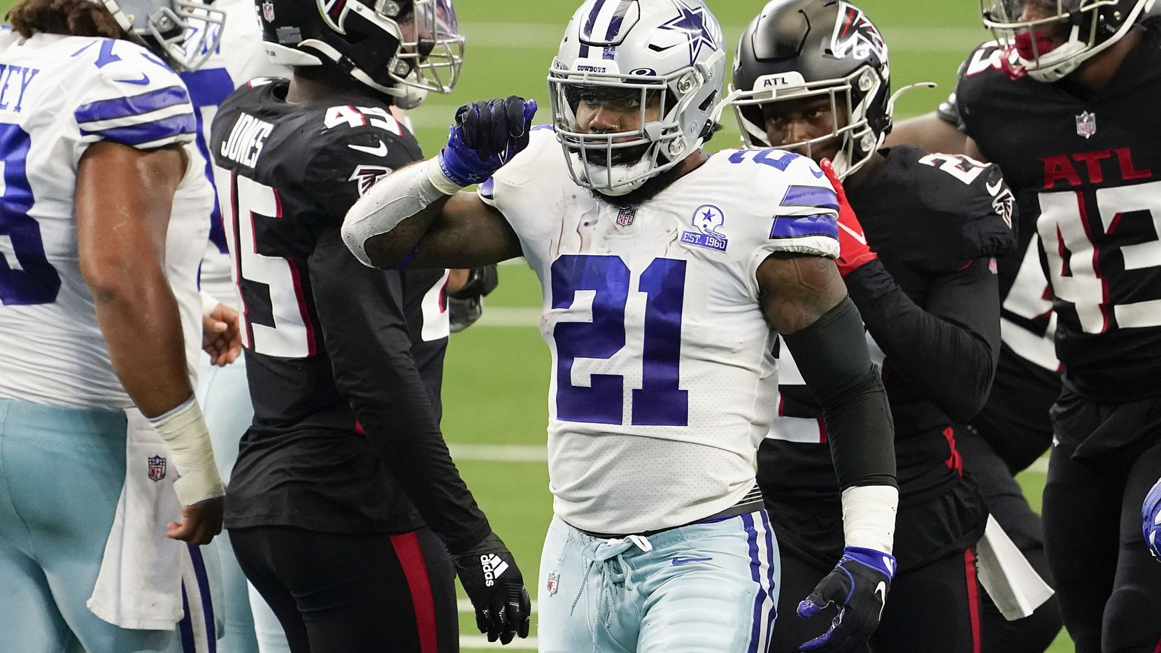 Cowboys running back Ezekiel Elliott celebrates after picking up a first down during the second quarter of a game against the Falcons at AT&T Stadium on Sunday, Sept. 20, 2020, in Arlington.