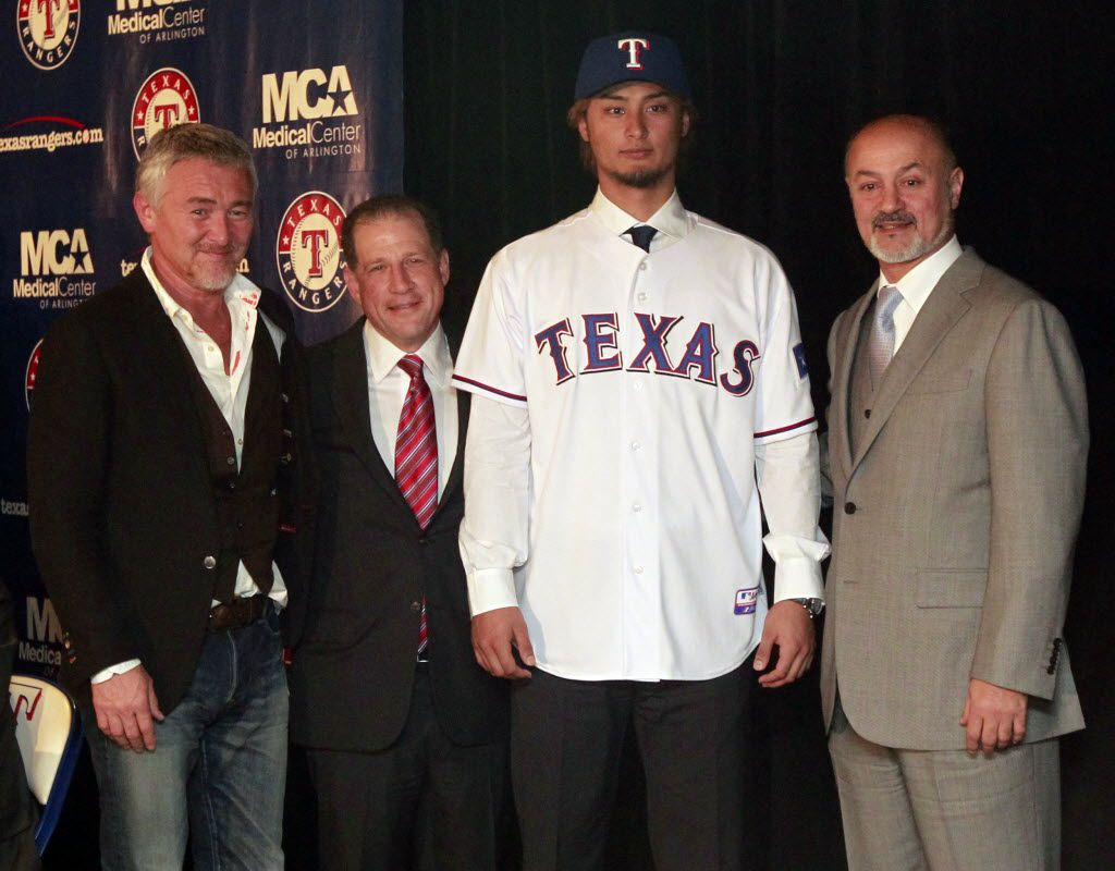 New Texas Rangers pitcher Yu Darvish poses for photos with agent Don Nomura, left, agent Arn Tellem, second from left, and his father Farsad Darvish, right, after he was introduced as a Texas Ranger during  press conference at Rangers Ballpark in Arlington on Friday, January 20, 2012. (Michael Ainsworth/The Dallas Morning News) / mug - mugshot - headshot - portrait //  01222012xSPORTS 04092012xMETRO